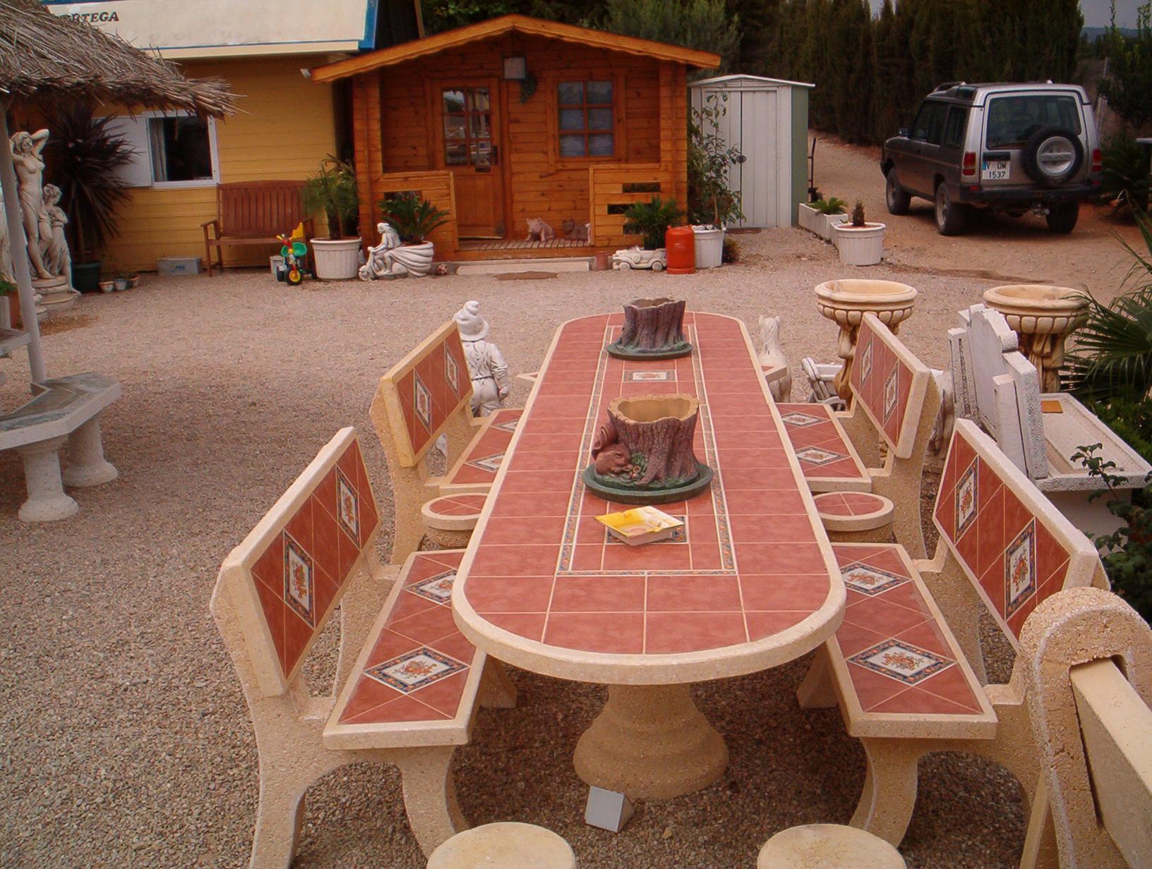 Conjunto mesa oval 3m en piedra artificial ana parra for Banco de piedra para jardin